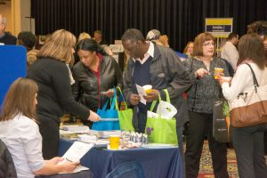 Attendees collect resources from Expo vendors